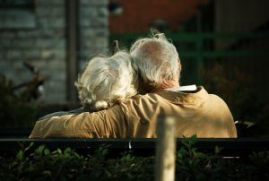 mature couple on park bench